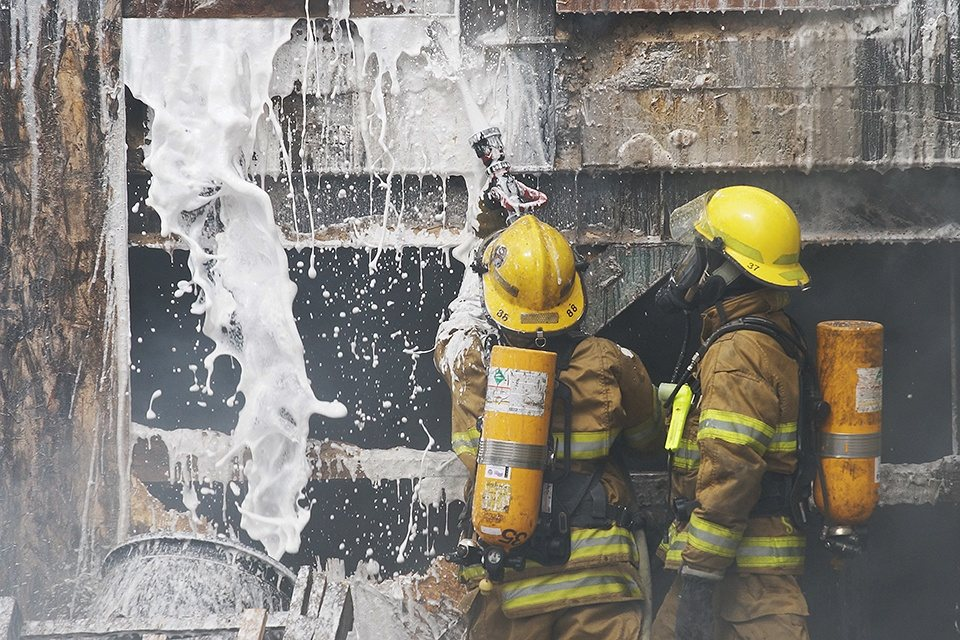 Firefighters using aqueous film forming foam or AFFF